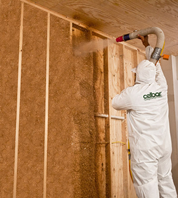 Celbar being sprayed into a wall cavity